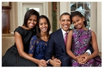 This print depicts the Obama First Family in a posed family portrait.