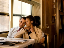 This print is a photograph of Barack and Michelle Obama sharing a quiet moment together in a diner.