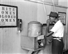 "Drinking at ""Colored"" Water Cooler in Streetcar Terminal, Oklahoma City, Oklahoma, 1939"
