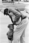 African American Man with Crying Child, 1962