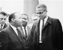 A photo print of Dr Martin Luther King and Malcolm X in conversation
