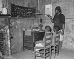 Sharecropper Mother Teaching Children Numbers and Alphabet, Transylvania, LA, 1939